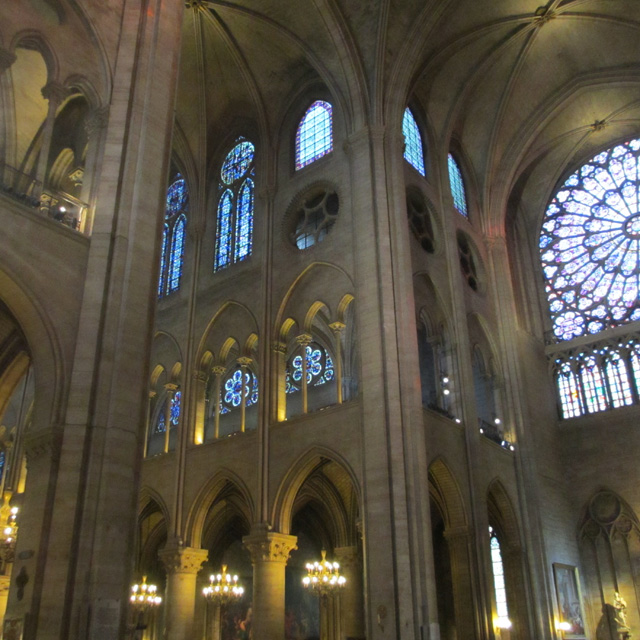 The arched ceiling and tiered interior of Notre-Dame