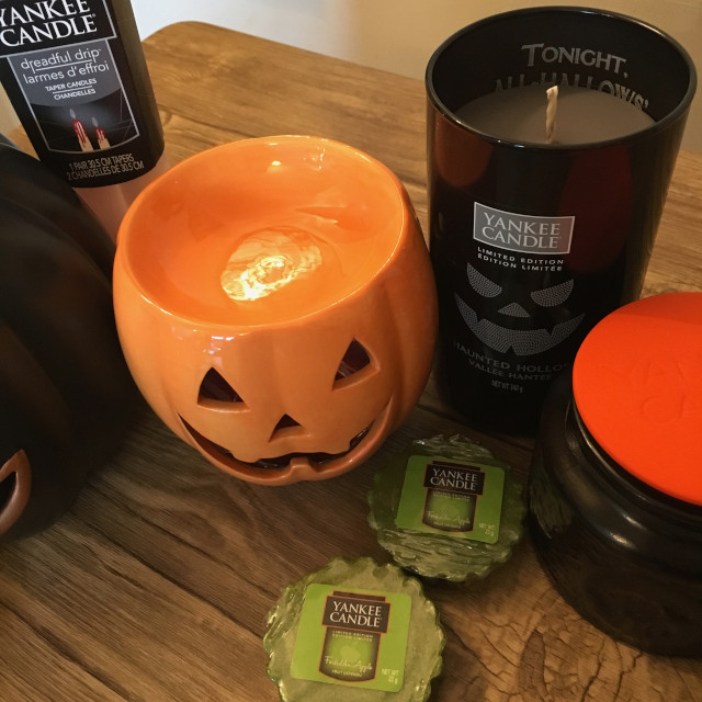 A close up of Halloween candles and a pumpkin-shaped warmer from Yankee Candle