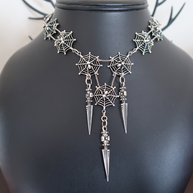 A large spiderweb necklace in sterling silver
